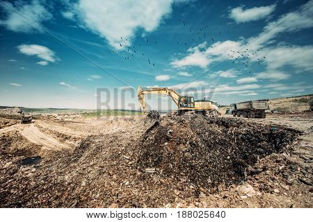 Industrial Excavator Using Heavy Duty Scoop For Construction Works At Garbage Dumpsite