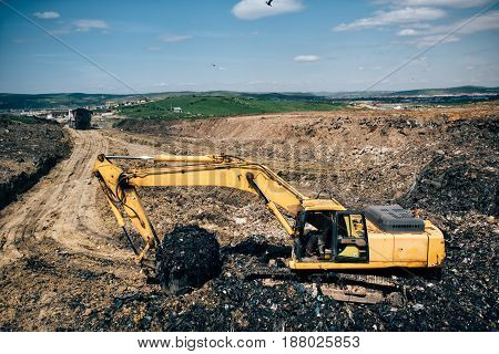 Backhoe Excavator Machinery Digging And Working On Construction Site