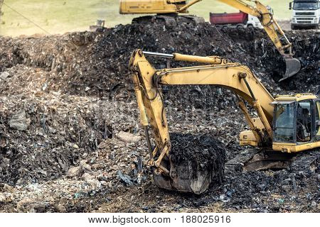 Monster Industrial Excavator Digging Into Trash At Urban Dumping Grounds
