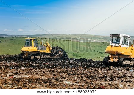 Industrial Bulldozers Working On Construction Site. Details Of Wasteland, Garbage Disposal Dumping G
