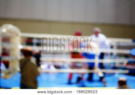 Boxing bout theme creative abstract blur background with bokeh effect. Not sharp picture as a background wallpaper sport battle boxers in the ring