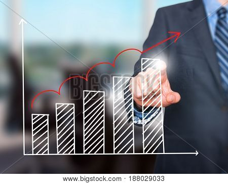 Businessman Hand Drawing Growth Graph On Visual Screen