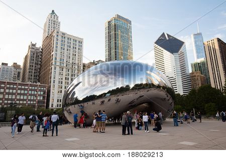 Chicago, USA - October 17 2016: Cloud gate, otherwise nown as 'The Bean' in Millenium Park at dusk on a hot summer's afternoon