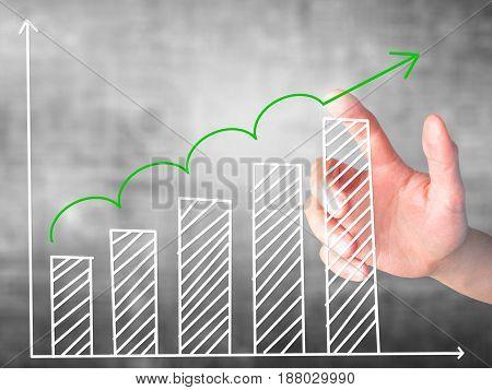 Businessman Hand Pressing Sales Growth Graph On Virtual Screen.
