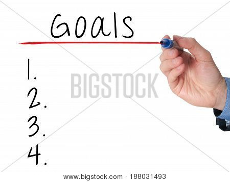 Businessman Is Writing Goals List,  Planning On Whiteboard