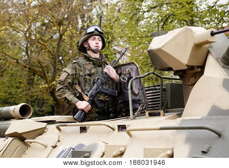 RUSSIAN KOZELSK MAY 9 2017 Victory Day May 9. Military Parade on anniversary of Victory in Great Patriotic War. Fighting vehicle. Soldier on Russian armored troop-carrier