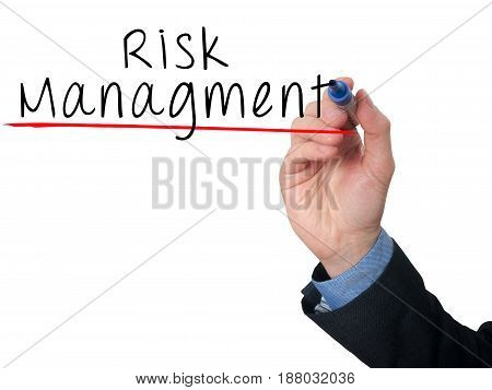 Businessman Is Writing Risk Management On The Transparent Board