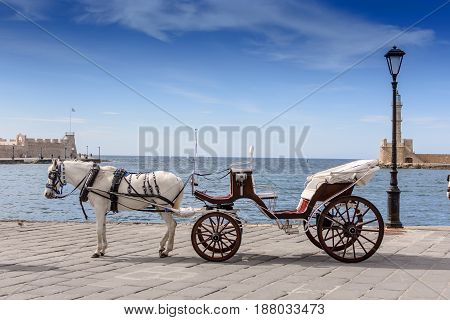 Carriage With A Horse In The Port On The Background Of The Sea