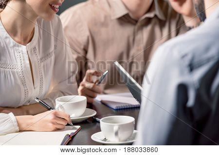 Business Team On Meeting Discussing Project In Cafe, Business Lunch Concept
