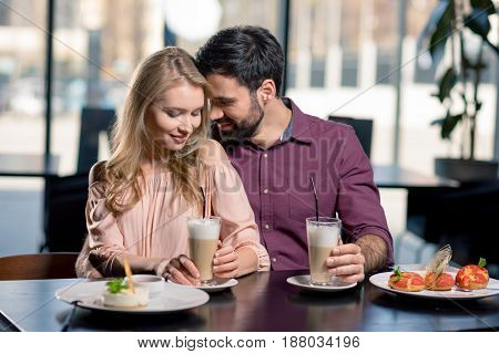 Romantic Couple In Love Spending Time Together On Coffee Break In Restaurant
