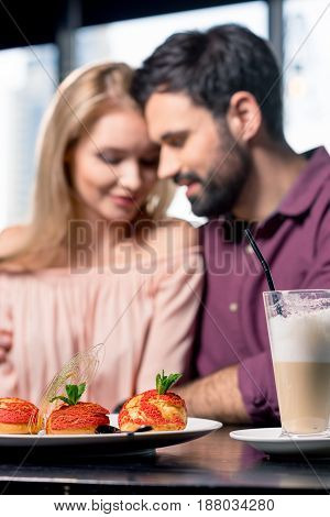 Romantic Couple In Love Spending Time Together On Coffee Break In Restaurant, Focus On Foreground