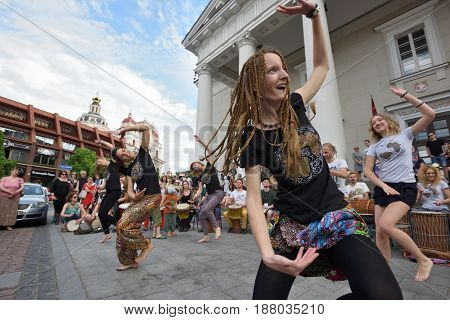 VILNIUS LITHUANIA - MAY 20: Unidentified musicians play drums and dancing in Street Music Day on May 20 2017 in Vilnius. Its a most popular event on May in Vilnius Lithuania