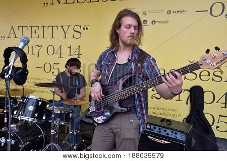 VILNIUS LITHUANIA - MAY 20: Unidentified musician play guitar in Street Music Day on May 20 2017 in Vilnius. Its a most popular event on May in Vilnius Lithuania