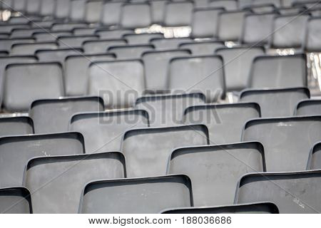 Many empty chairs without audience detail close up