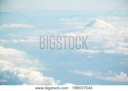 Fuji mountain in Japan with the group of cloud in the aerial view background