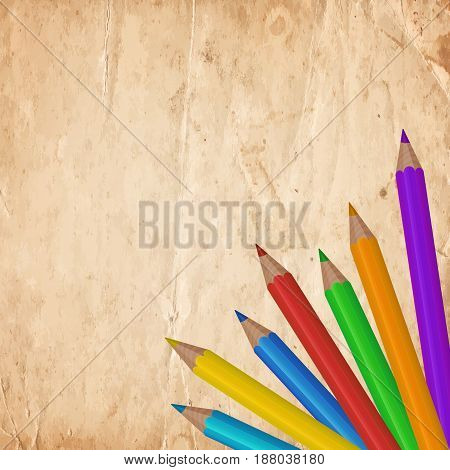 Colorful Pencils On The Old Paper Background