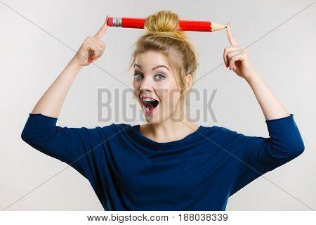 Happy Blonde Woman Having Big Pencil In Hair