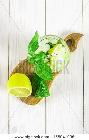 Sassy Diet Water. Cucumber, Lemon, Mint Lemonade In Glasses On White Wooden Table. Top View. Selecti