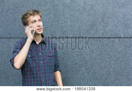 Young man talking on phone outdoor copy space. Guy have important talk. Communication, modern technologies, busy people concept