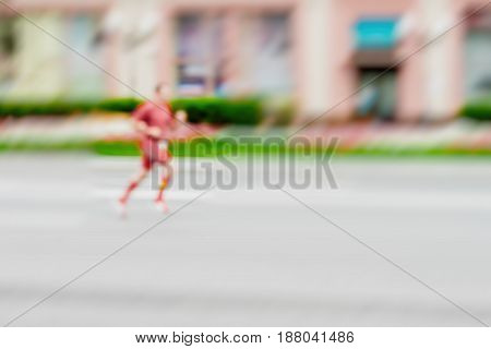 Runner athlete running on the street, city marathon, blur effect, unrecognizable face. Sport, fitness and healthy lifestyle concept. For modern backdrop, place for your text