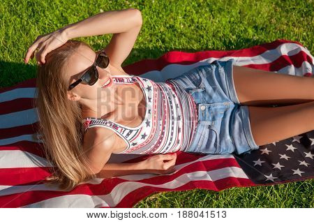 Young happy patriot woman with United States flag