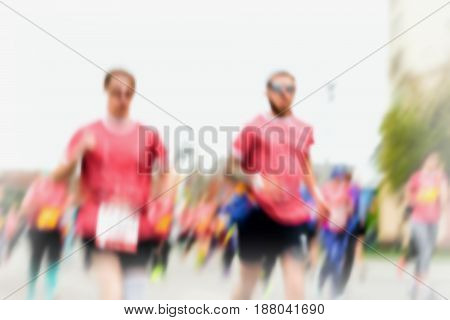 Blurred abstract motion group runners on the city street. Fitness and healthy lifestyle, sport activity concept. Athletes on the race. Sport activity. Modern backdrop, wallpaper, banner design