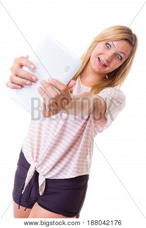Modern devices social media photography concept. Blonde woman taking self picture selfie with tablet. Studio shot isolated