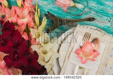 Tableware And Silverware With Light Pink, White And Red Gladiolus On The Azure Background