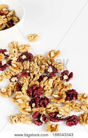 Walnut kernels halves on a white background