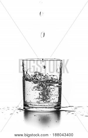 Liquid pouring into a glass on a white background