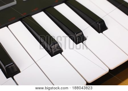 Musical instrument - Sloseup MIDI piano black and white keyboard.