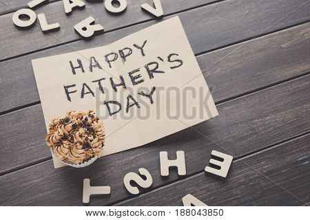 Happy Fathers Day card mockup, cupcake on rustic wood background