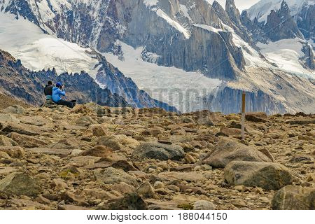 SANTA CRUZ, ARGENTINA, MARCH - 2016 - Two men taking photos to snowy andes mountains at Parque Nacional Los Glaciares Argentina