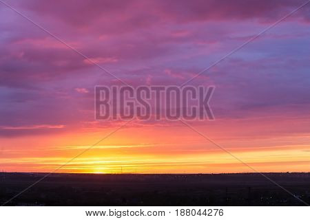 Bright sunset with clouds and the sun on the horizon