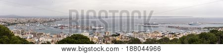 Panoramic aereal view of Palma de Mallorca cloudy day, Spain. Bay harbor with many sailboats and Luxury cruises