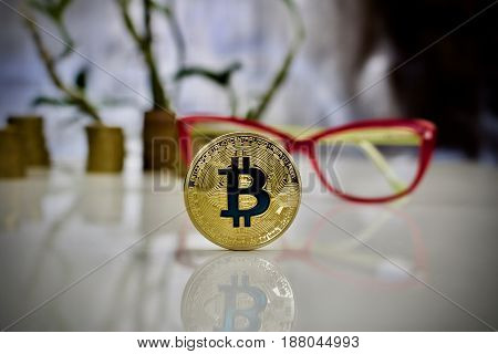 Gold Bitcoin Coin Near Pink Glasses