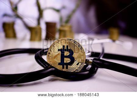 Gold Bitcoin Coin - Stethoscope Concept