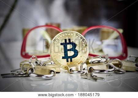 Gold Bitcoin Coin, Padlocks And Glasses
