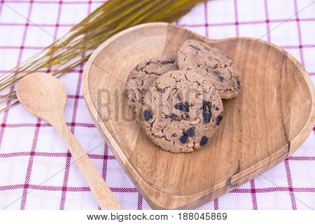Chocolate chip cookies on background of brown.