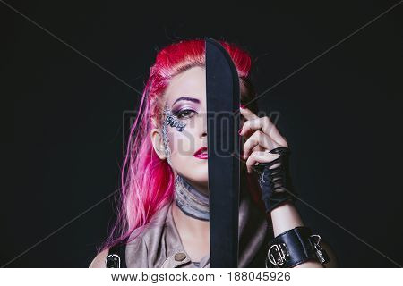 Female Model With Body Painting Futuristic On The Face And Clothes Of Punk Style