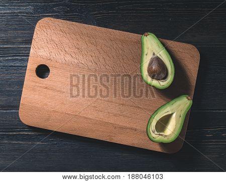 Fresh Avocado Cut Into Two Halves With Bone