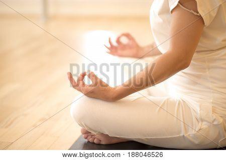 Woman Sitting In Lotos Pose