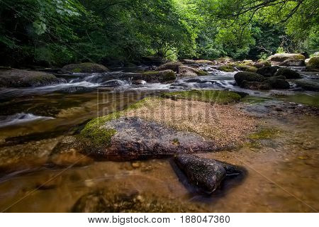 A river with a fast current in the forest. Rocky river. East Dart. Dartmoor National Park. Devonshire. England