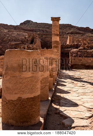 A row of pillars which are part of the ruins of what may have been a Great Temple at Petra in Jordan.