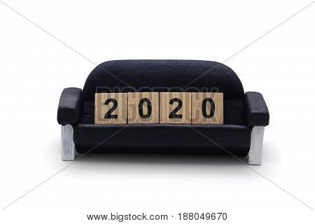 Isolated 2020 Dice On The Miniature Sofa On White Background