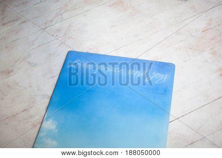blue yoga Mat lying on a white floor