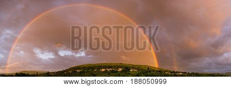 Double rainbow over Bathampton. Panorama of countryside on outskirts of Bath UK following heavy May showers