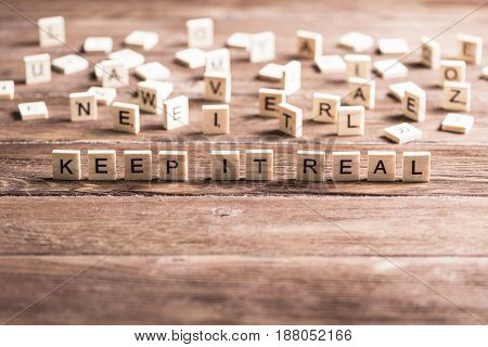 keep it real phrase collected of wooden elements with the letters