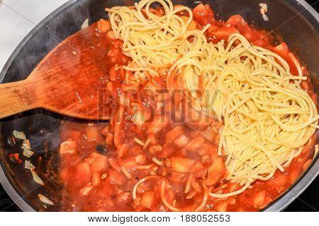 Closeup Cooking Shrimp/prawn Spaghetti Tomato Sauce With Spade Of Frying Pan
