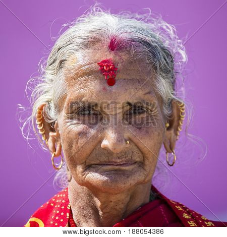 KATHMANDU NEPAL - OCTOBER 07 2016 : Portrait old woman in traditional dress in street Kathmandu Nepal